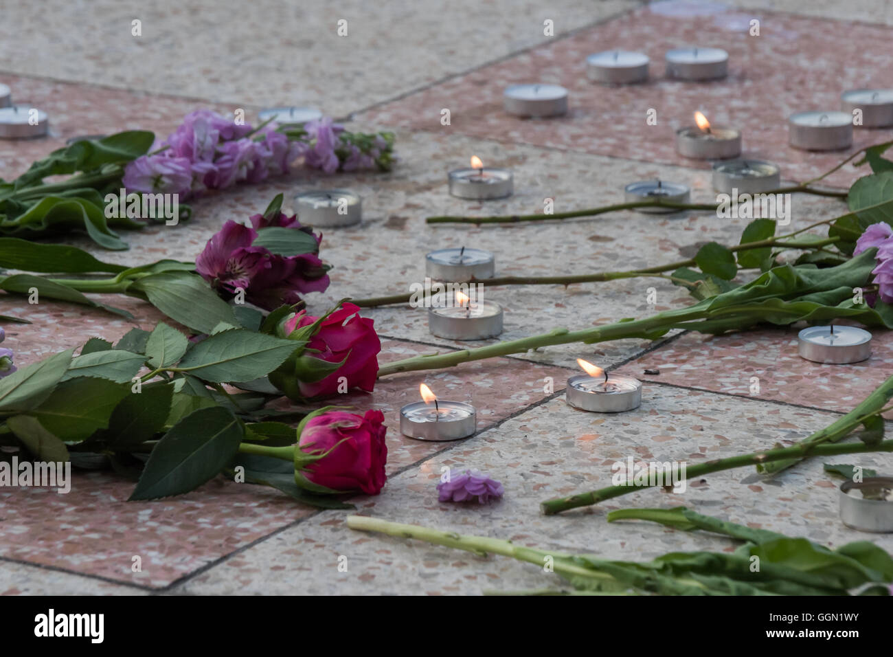 London, UK. 5th Aug, 2016. Sisters Uncut set up flowers and candles in Altab Ali Park in East London to commemorate - Stock Image