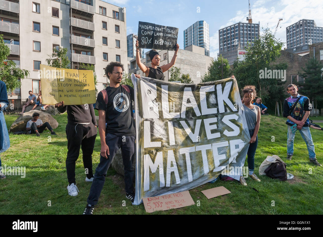 London, UK. 5th Aug, 2016. People pose with placards and the 'Black Lives Matter ' banner at the start of - Stock Image
