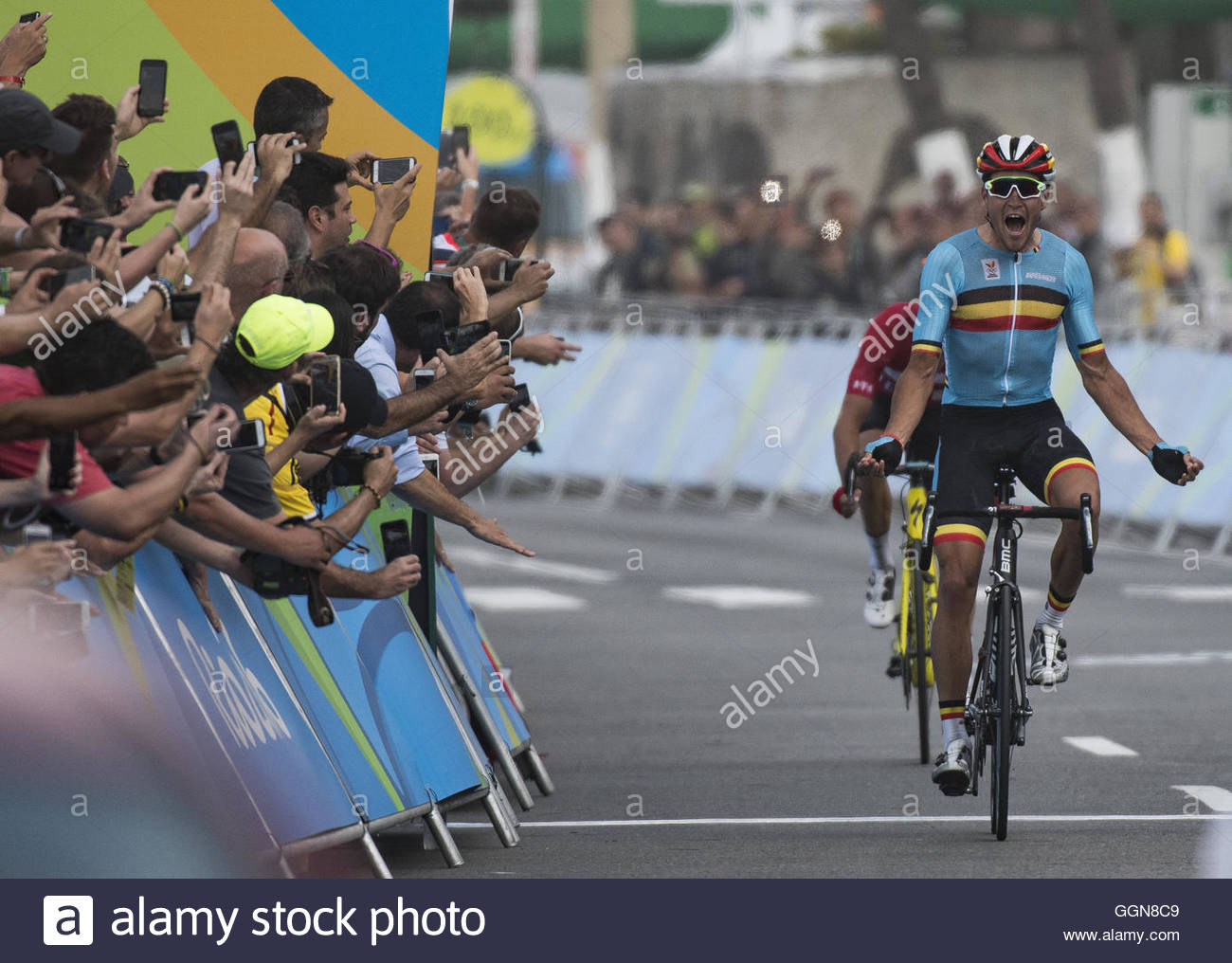 d7fa98299 Greg VAN AVERMAET of Belgium celebrates as he crosses the finish line to win  the gold medal in the men s road cycling at the ...