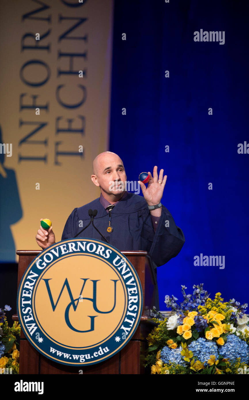 Speaker at podium during commencement ceremony for Western Governors University in Orlando, FL - Stock Image