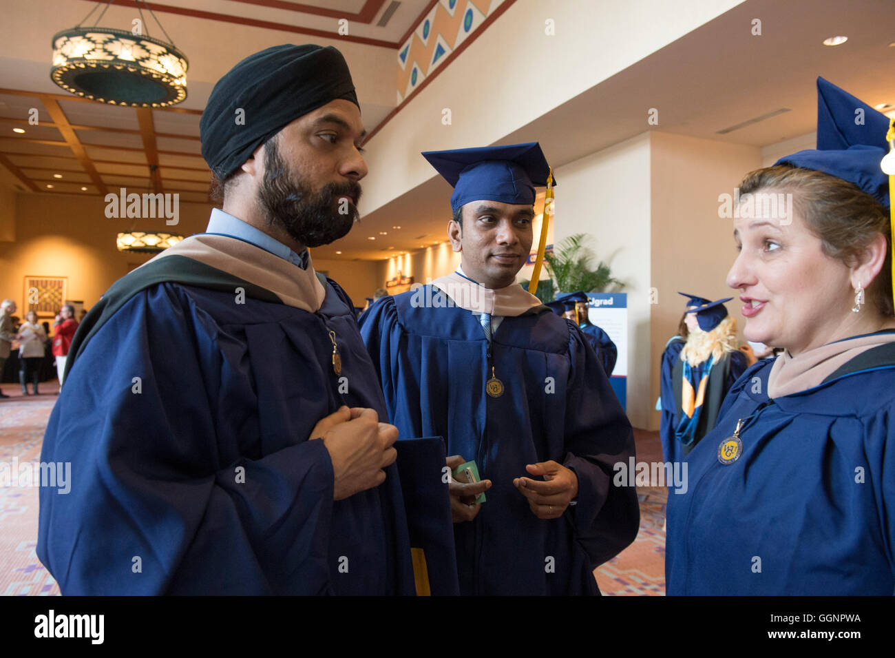 Graduation candidates in caps and gowns wait for Western Governors University commencement ceremony to begin in - Stock Image