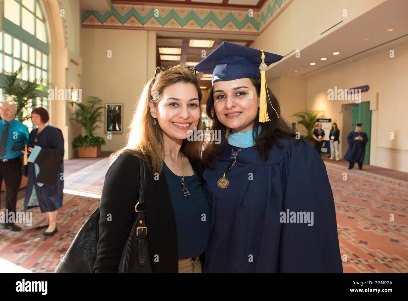 Graduate of Western Governors University poses with friend after