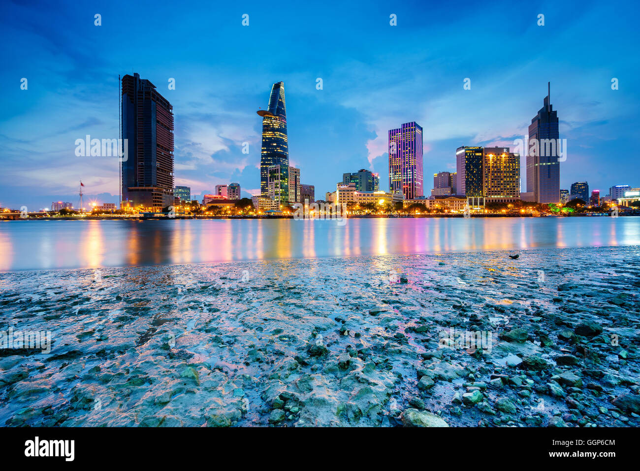 Night view of Business and Administrative Center of Ho Chi Minh city on Saigon riverbank in twilight, Vietnam Stock Photo
