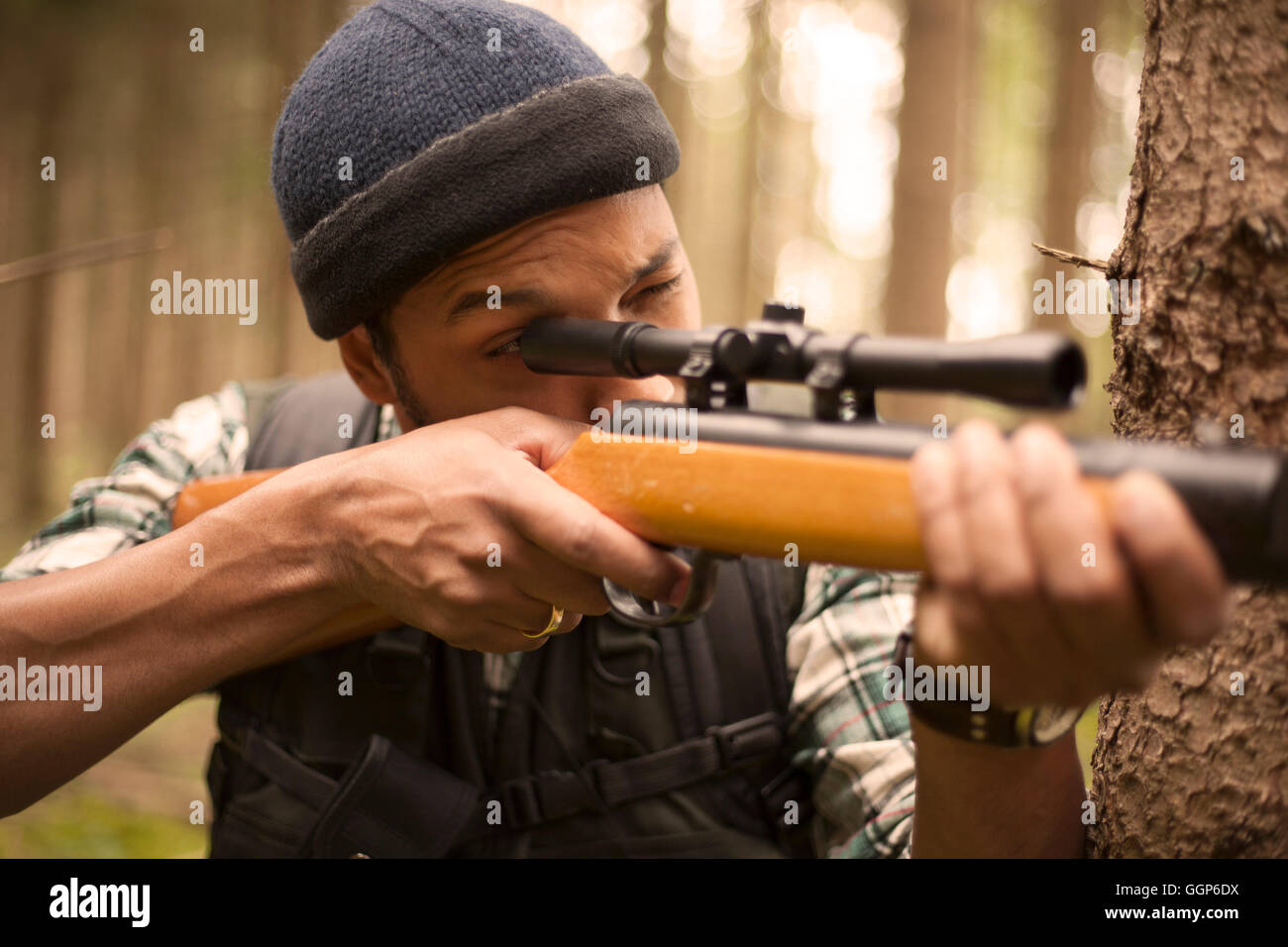 Interracial hunter in the forest Stock Photo