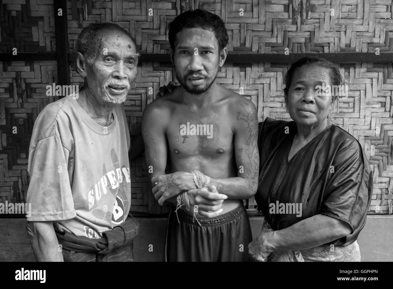 Ignasius Hengki Sesara, 35 suffers from mental illness. His family, father Hendrikus Mosa, 85 years old and mother, - Stock Image