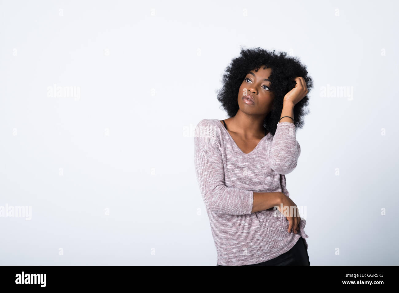 Fashion portrait of an Afro caribbean woman - Stock Image