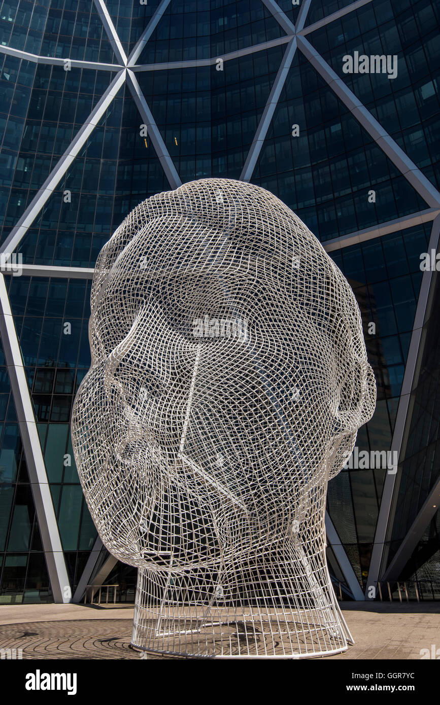"The ""Wonderland"" sculpture by Spanish artist Jaume Plensa in front of the Bow skyscraper, Calgary, Alberta, Canada - Stock Image"