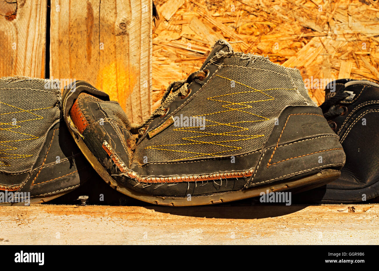 Very old pair of worn out Free Balance trainers - Stock Image