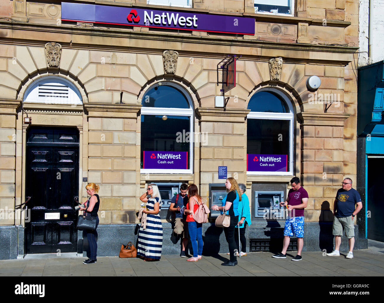 People queueing up, waiting for the NatWest bank to open, Darlington, County Durham, England UK Stock Photo