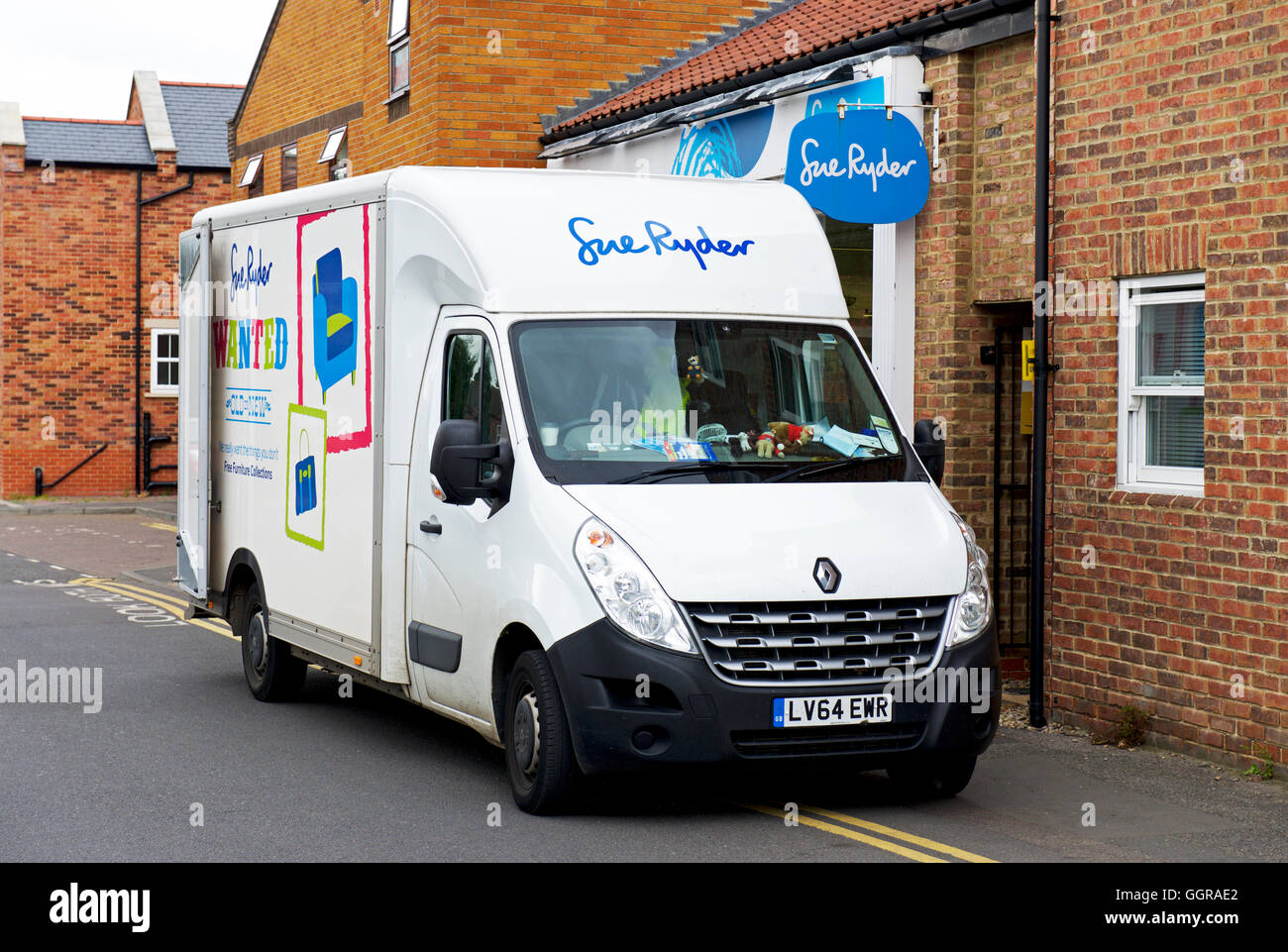 Van parked outside Sue Ryder charity shop, England UK - Stock Image