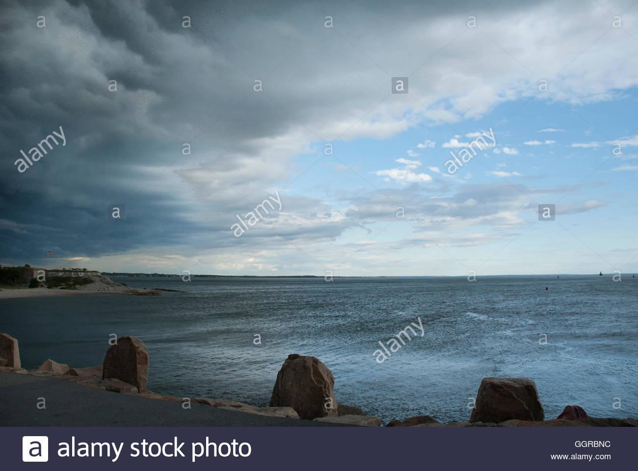 Summer storm passing over Fairhaven, Massachusetts - Stock Image