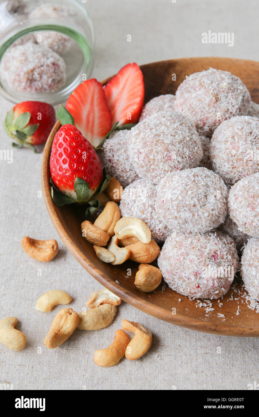 Homemade strawberry, date, cashew and coconut bliss ball - Stock Image