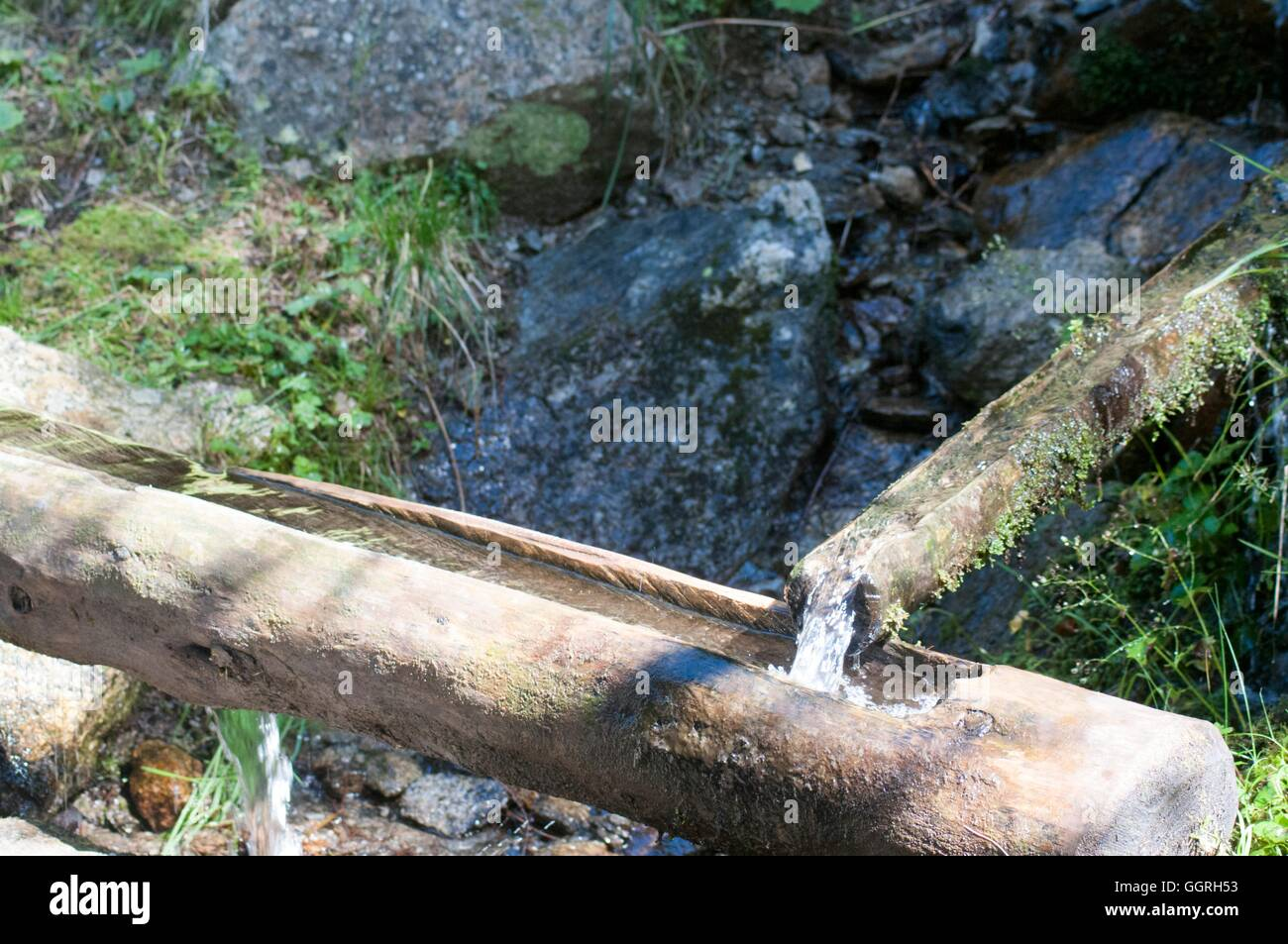 Wooden water ducts transfers water for irrigation - Stock Image