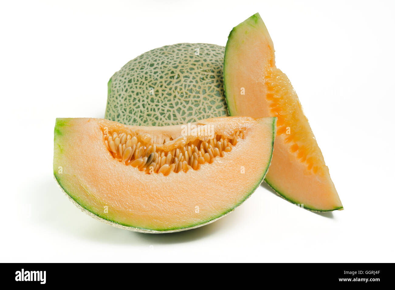 Sliced melon with seed on white (Other names are cantelope, cantaloup, honeydew, Crenshaw, casaba,  Persian melon, - Stock Image