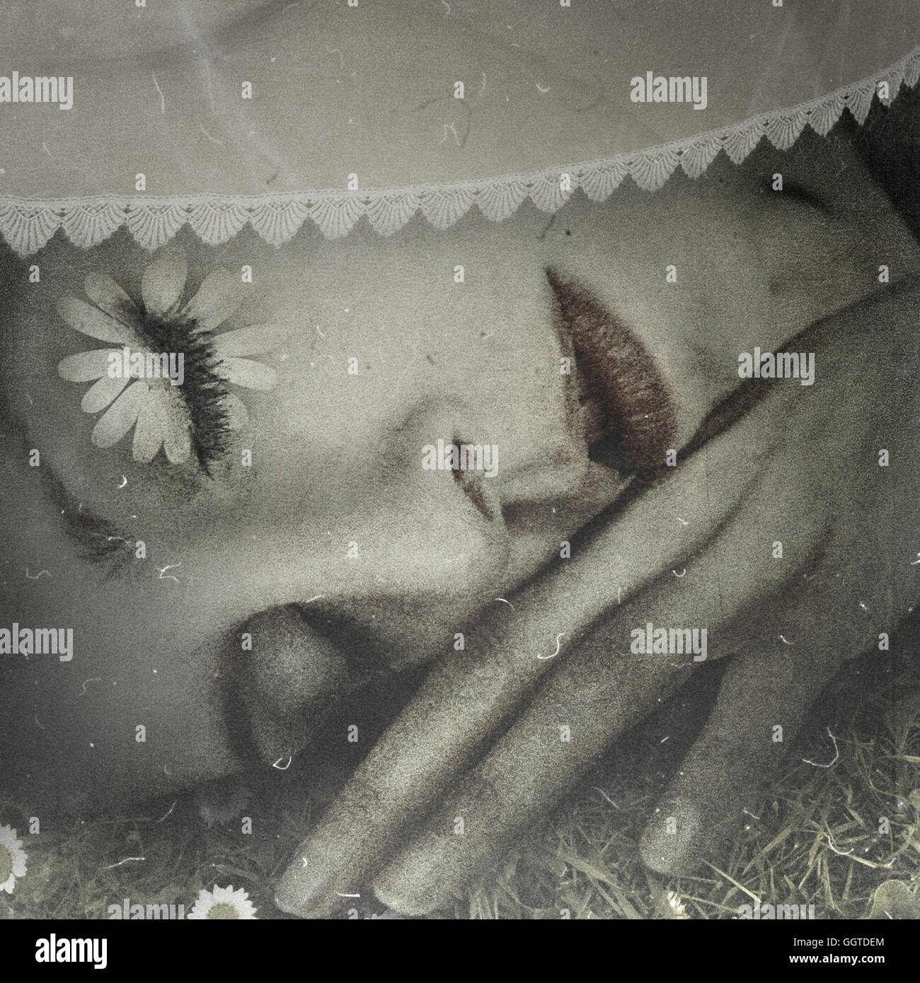 close up of sleeping young woman on grass - Stock Image