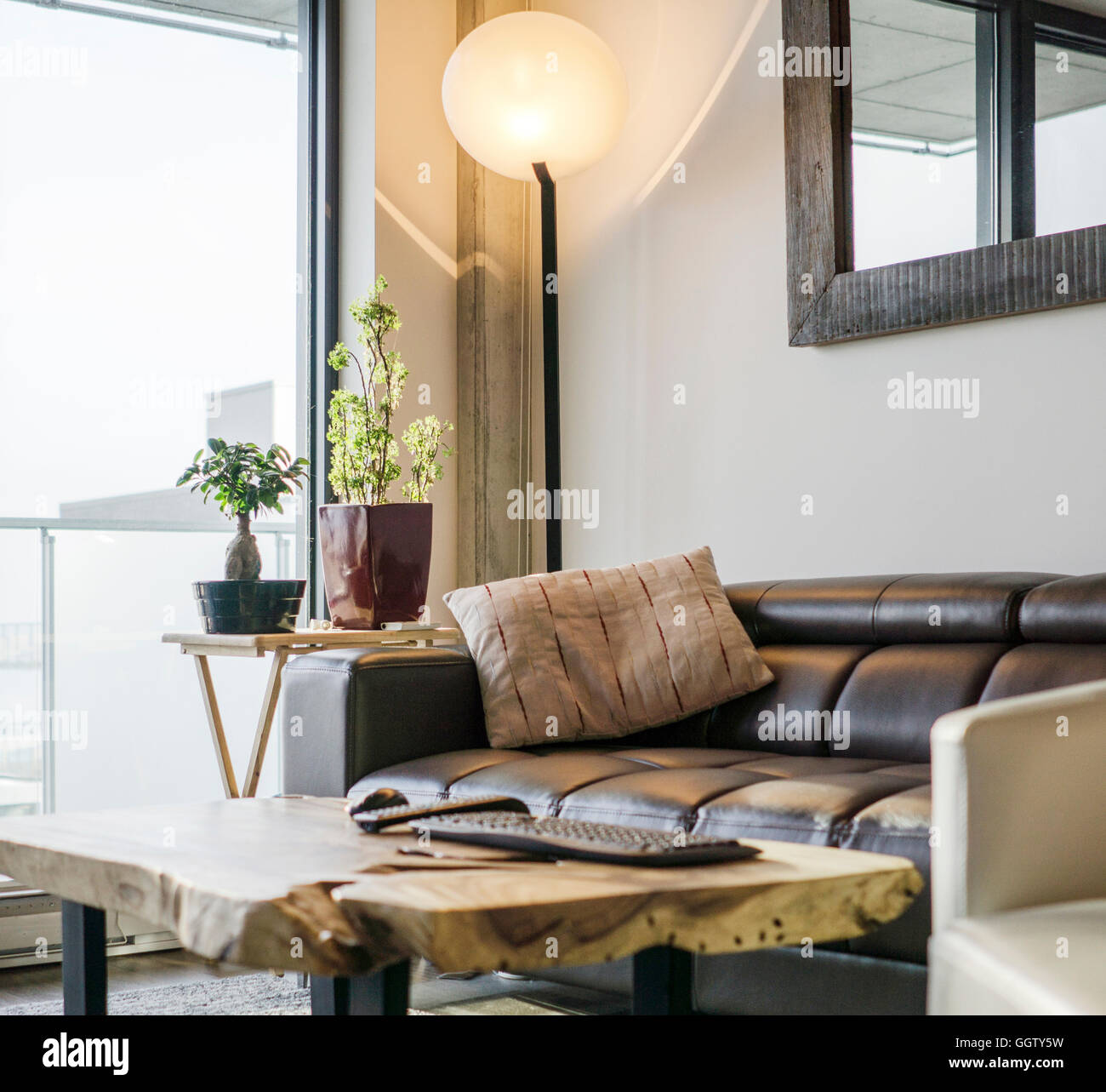 Sofa and armchair near livingroom window - Stock Image
