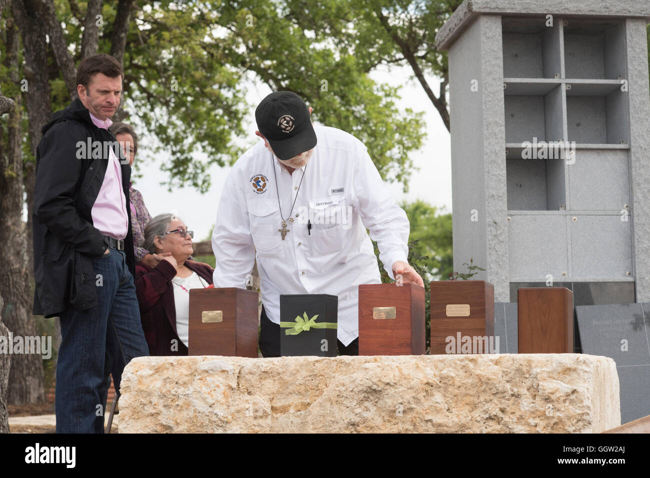 Boxes with ashes of homeless people who died on the streets of Austin TX displayed at memorial service as family Stock Photo