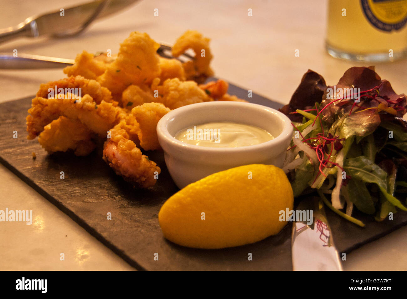 Fish and chips with mayonnaise, lemon and salad - Stock Image