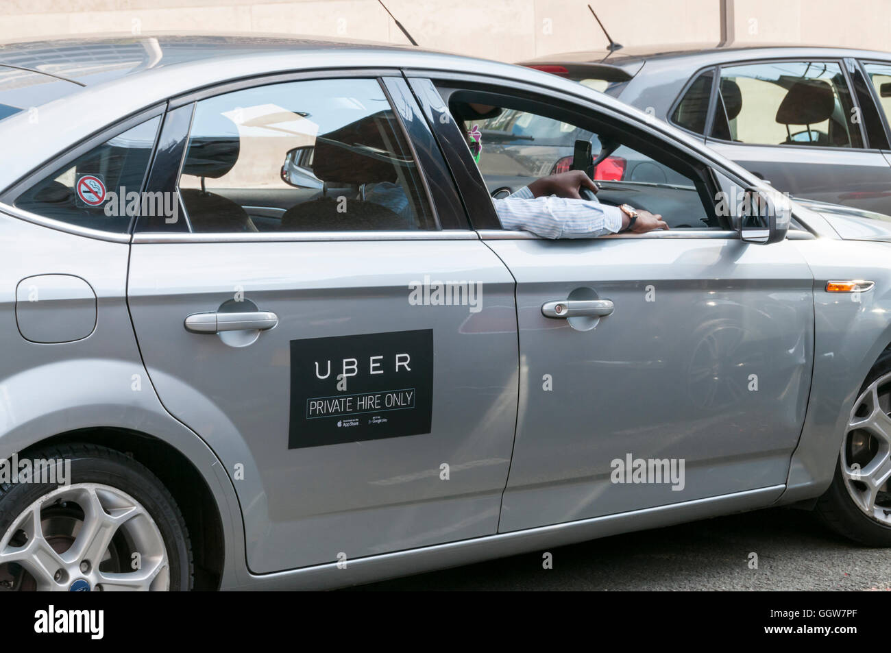 Uber car and driver. Stock Photo