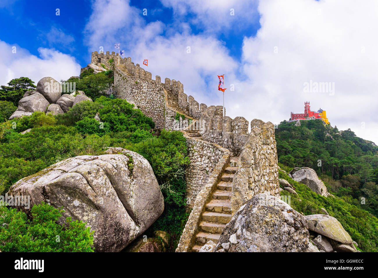Sintra, Portugal at Castle of the Moors wall with Pena National Palace in the distance. Stock Photo