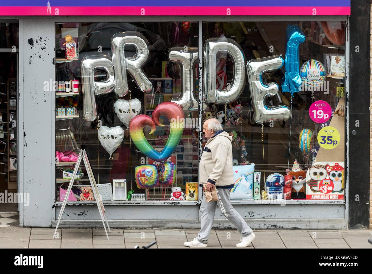 A shop window display celebrating Pride weekend in Brighton - Stock Image