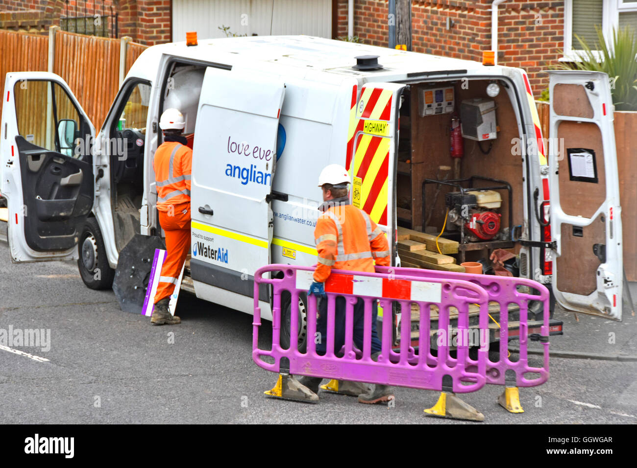Anglian Water crew & van attending UK England street sewer connection to residential property preparing to dig - Stock Image