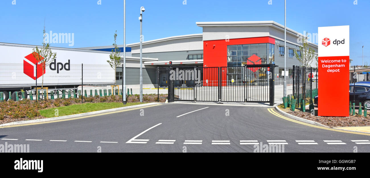 DPD supply chain parcel distribution depot and modern warehouse building & entrance gates with welcome sign - Stock Image