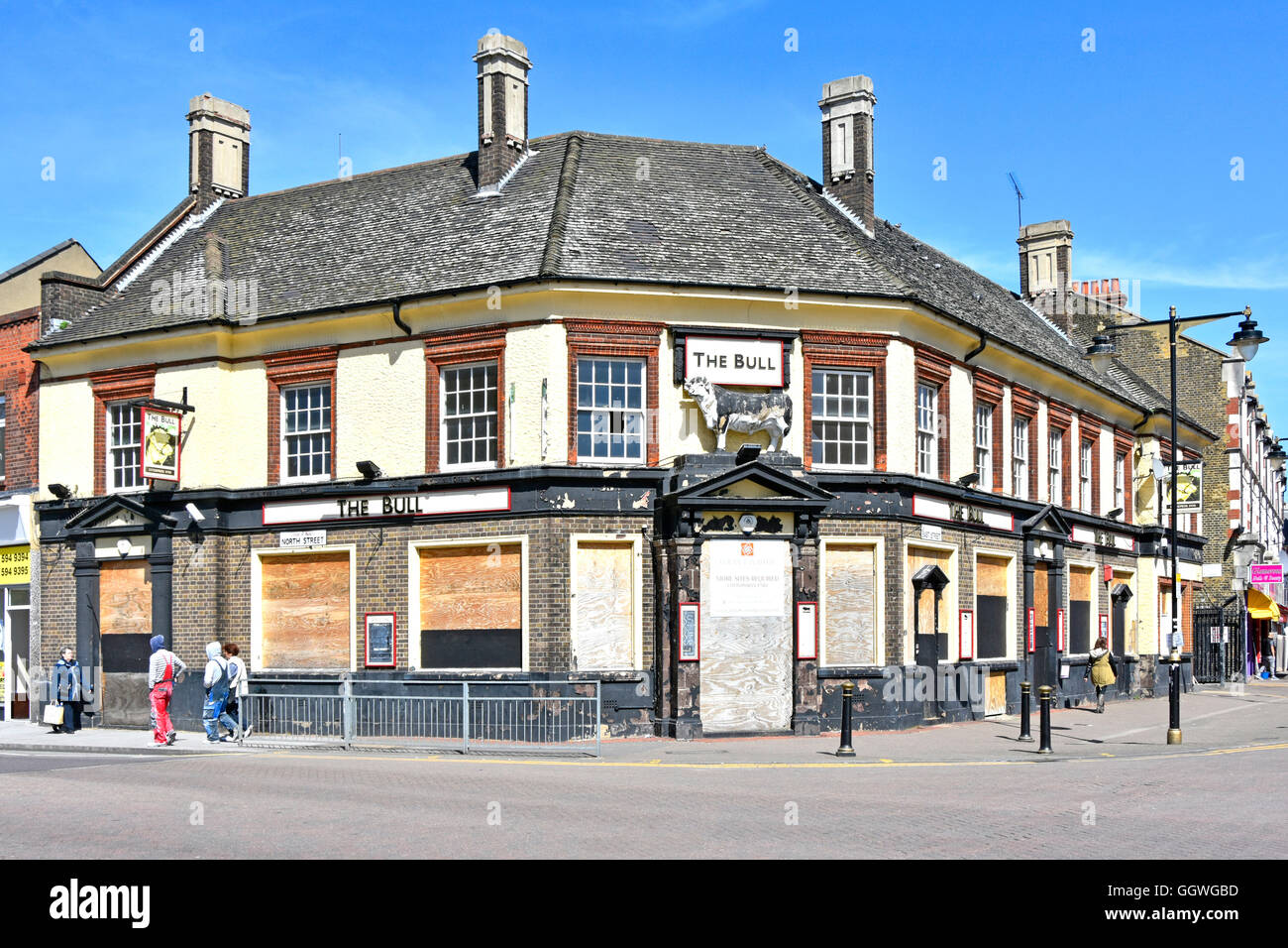 Bull Pub in Barking boarded up and awaiting redevelopment on a corner site junction of East and North Street London - Stock Image