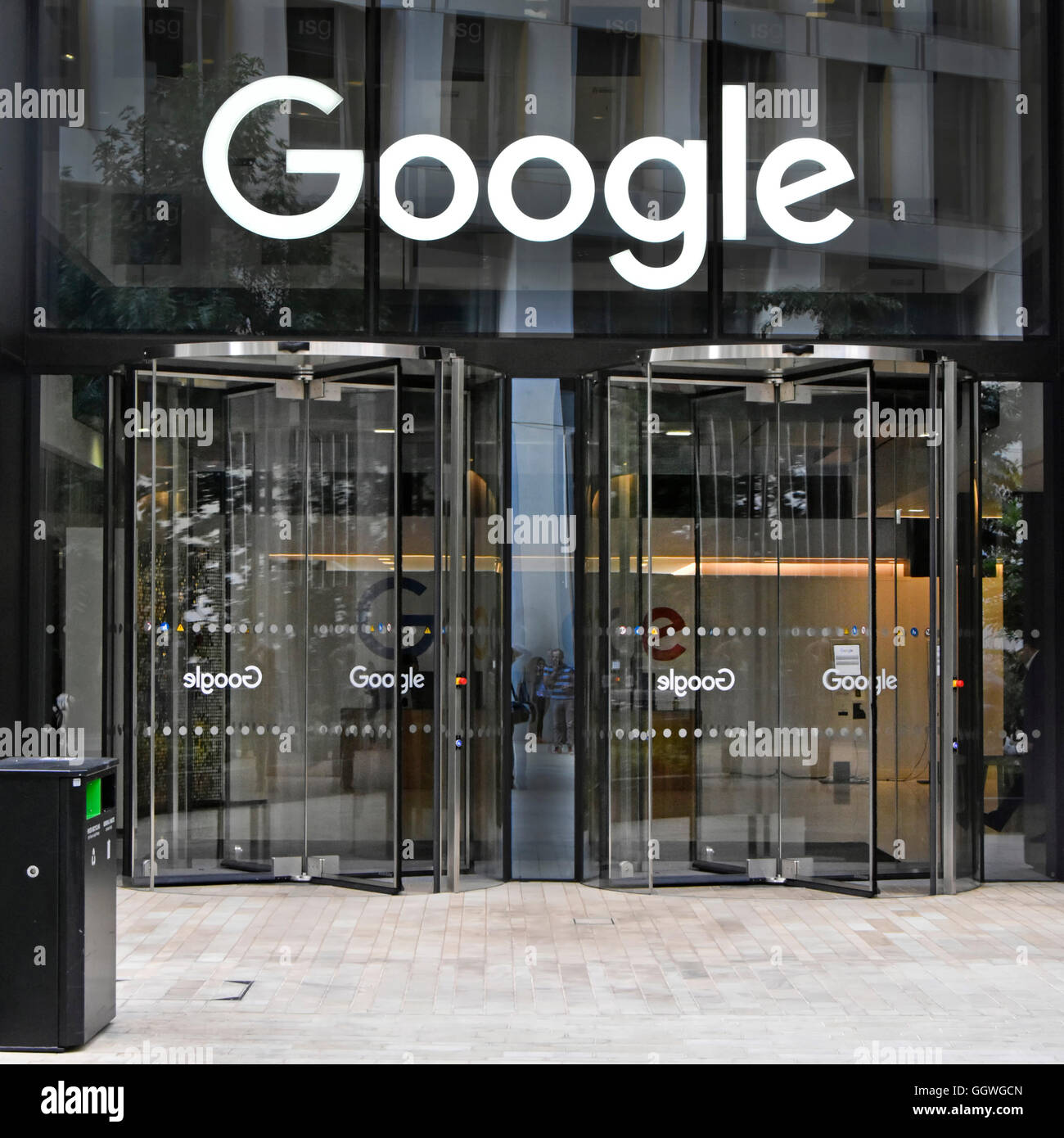 Glass doors to Google offices with sign above revolving entrance door to new office block in Kings Cross London England UK & Glass doors to Google offices with sign above revolving entrance ...