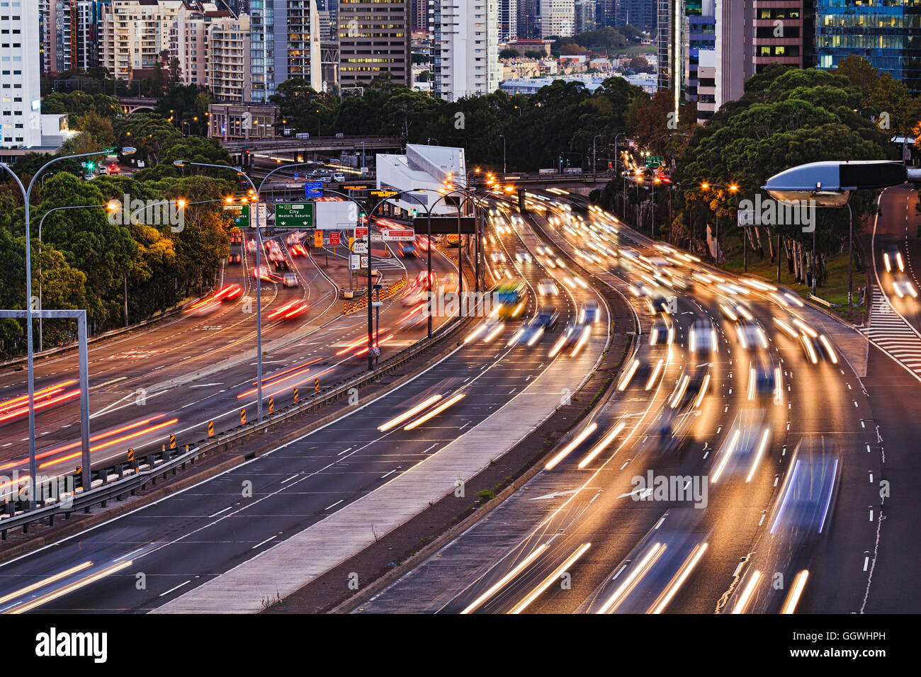 Busy warringah freeway motor road going through Sydney city CBD at sunset. Intense traffic lights blurred at long - Stock Image