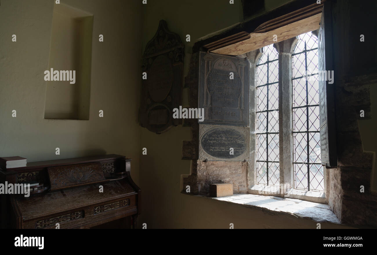 A window in the charming crooked church of St Martin's at Cwmyoy, Monmouthshire. - Stock Image