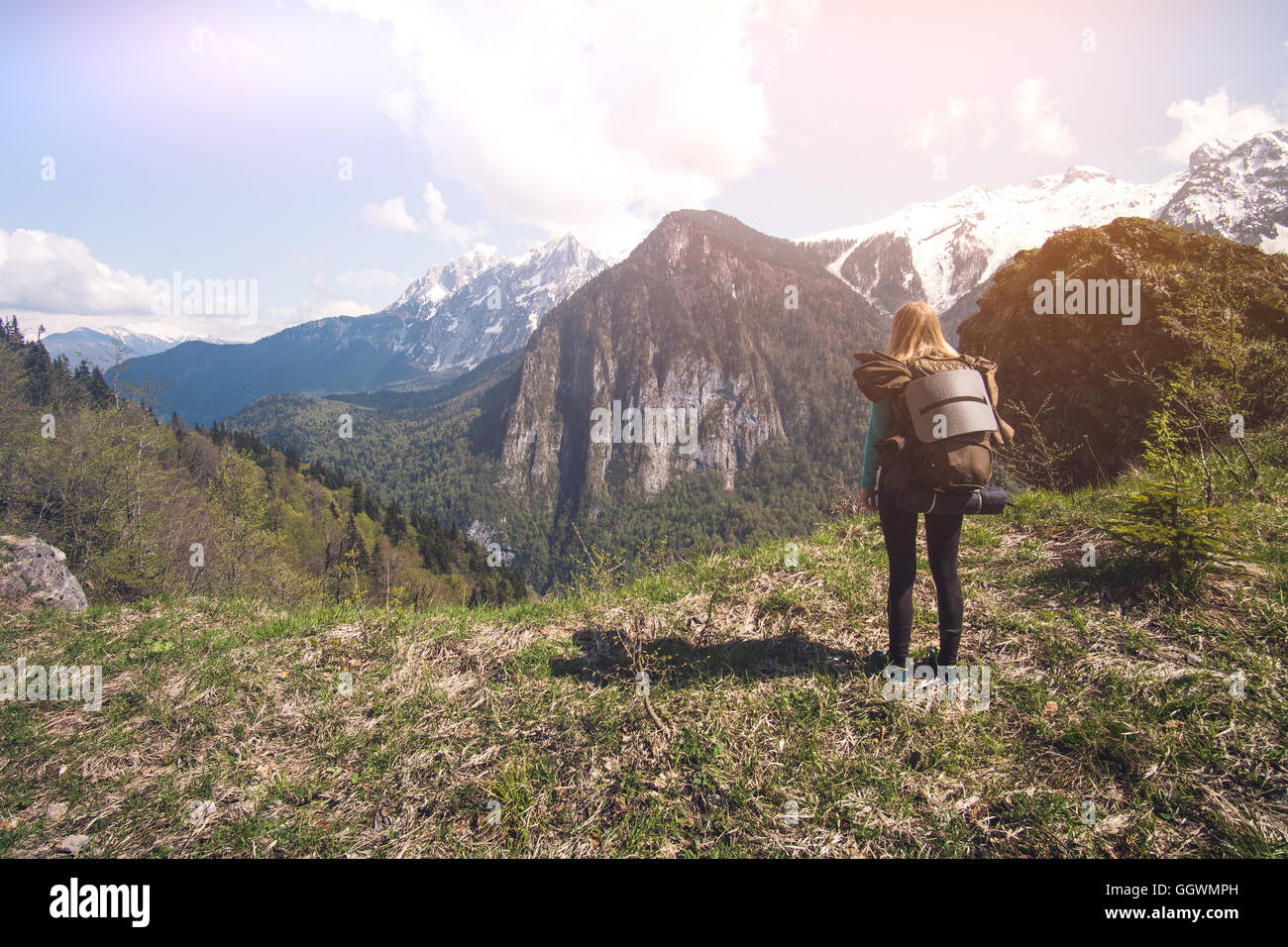 Woman Traveler with backpack hiking outdoor Travel Lifestyle concept forest on background Summer journey vacations - Stock Image