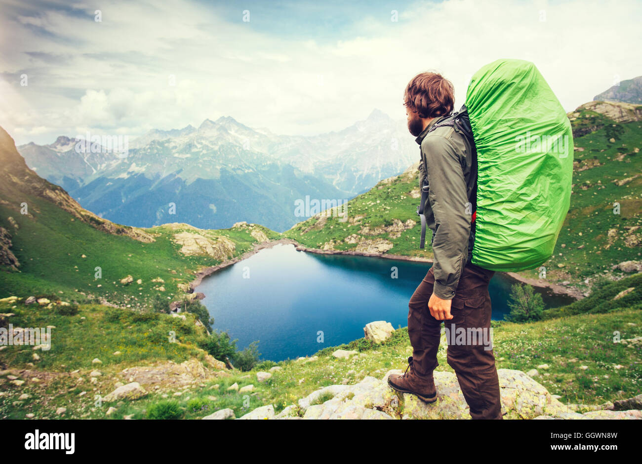 2ce42e5ff311 Man Traveler with big backpack hiking Travel Lifestyle concept lake and  mountains on background Summer adventure vacations outdo