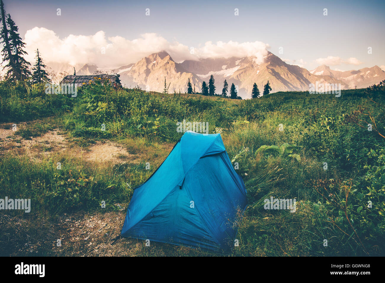 Tent camping with Rocky Mountains Landscape Travel Lifestyle concept Summer adventure vacations outdoor - Stock Image
