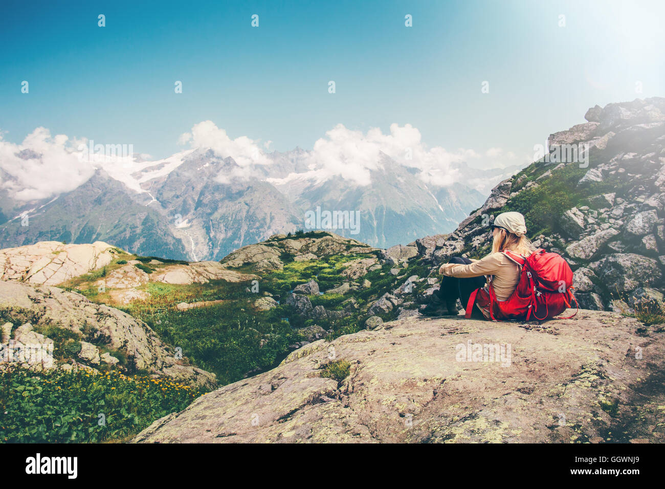 Woman Traveler with backpack relaxing with mountains serenity view Travel Lifestyle concept hiking adventure summer - Stock Image