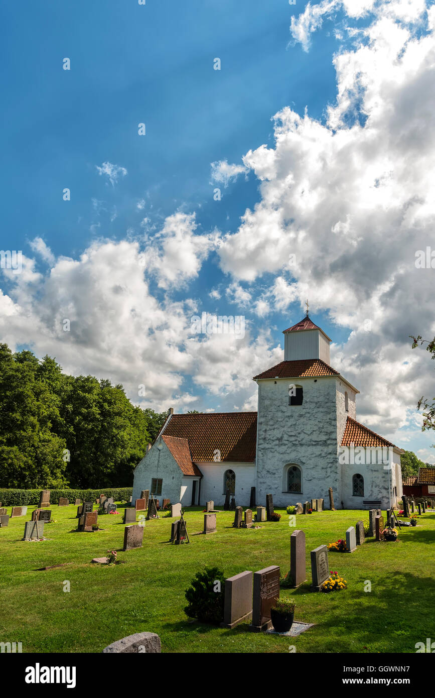 An image of the white stone church on the swedish island of Ivo. - Stock Image