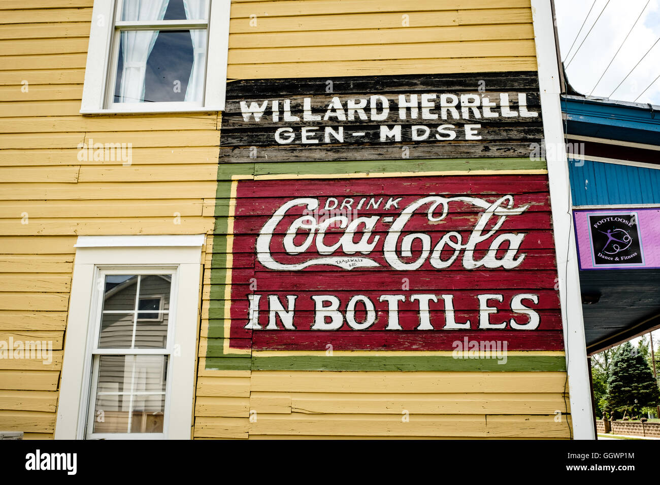 Painted Coca Cola sign, The Old Furniture Factory,  Art Music and Community Center, 6 West Loudoun Street, Round Stock Photo