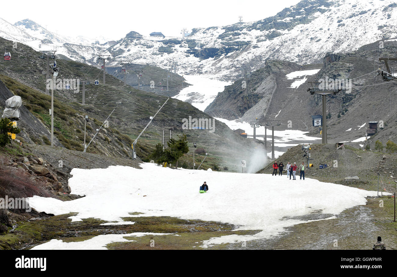 Last remaining snow on the Sierra Nevada ski run in Spain during May - Stock Image