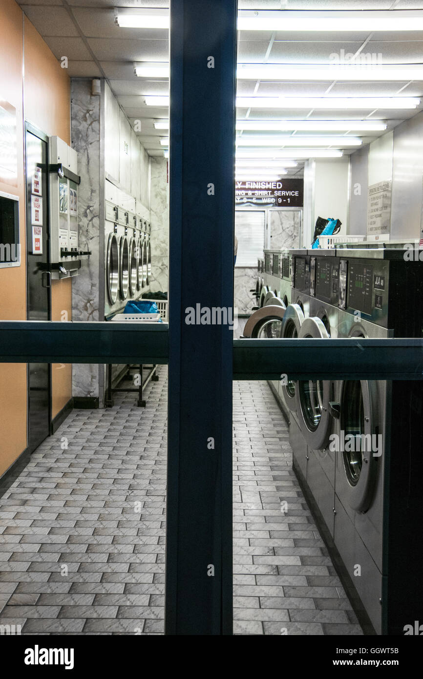 Launderette (UK) or washateria (US) - a self-service, coin-operated laundry facility - London, UK - Stock Image