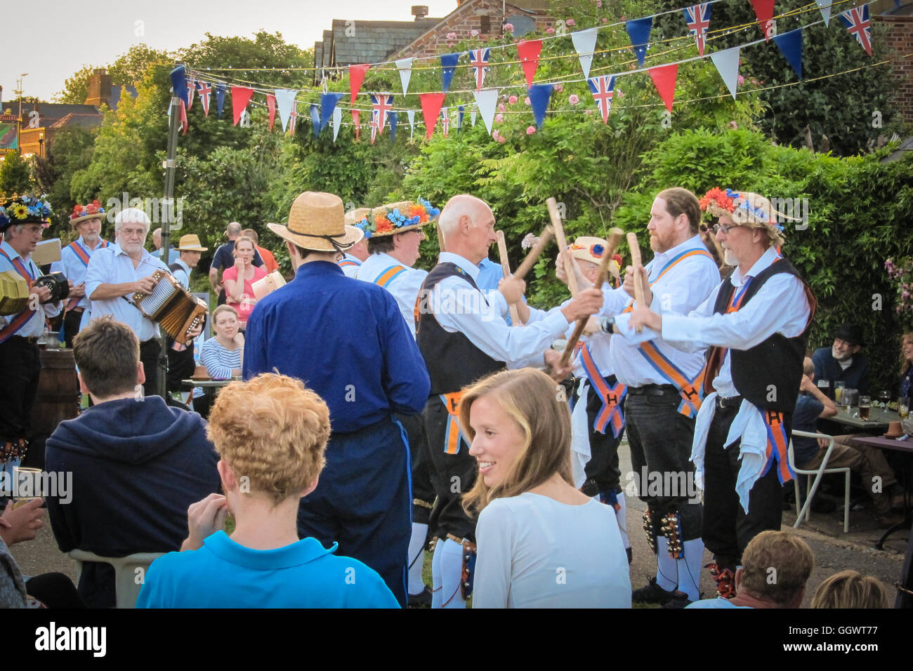 Morris dance is a form of English folk dance dating to the 1400's with rhythmic stepping, wielding sticks, swords, - Stock Image