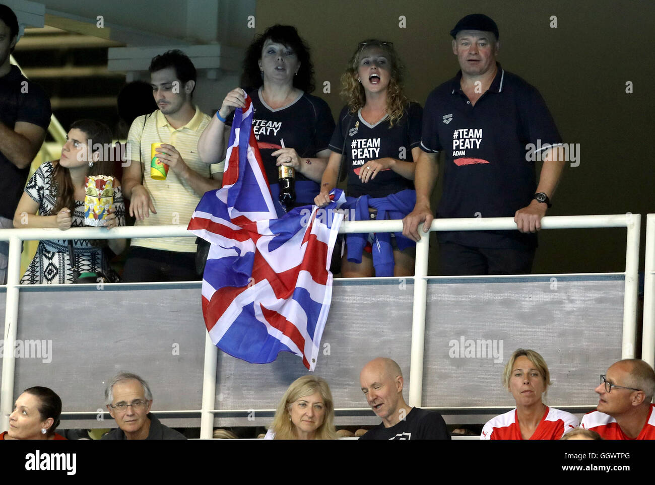 Mark and Caroline Peaty await the Men's 100m Final where their son will Adam will race for an Olympic medal - Stock Image