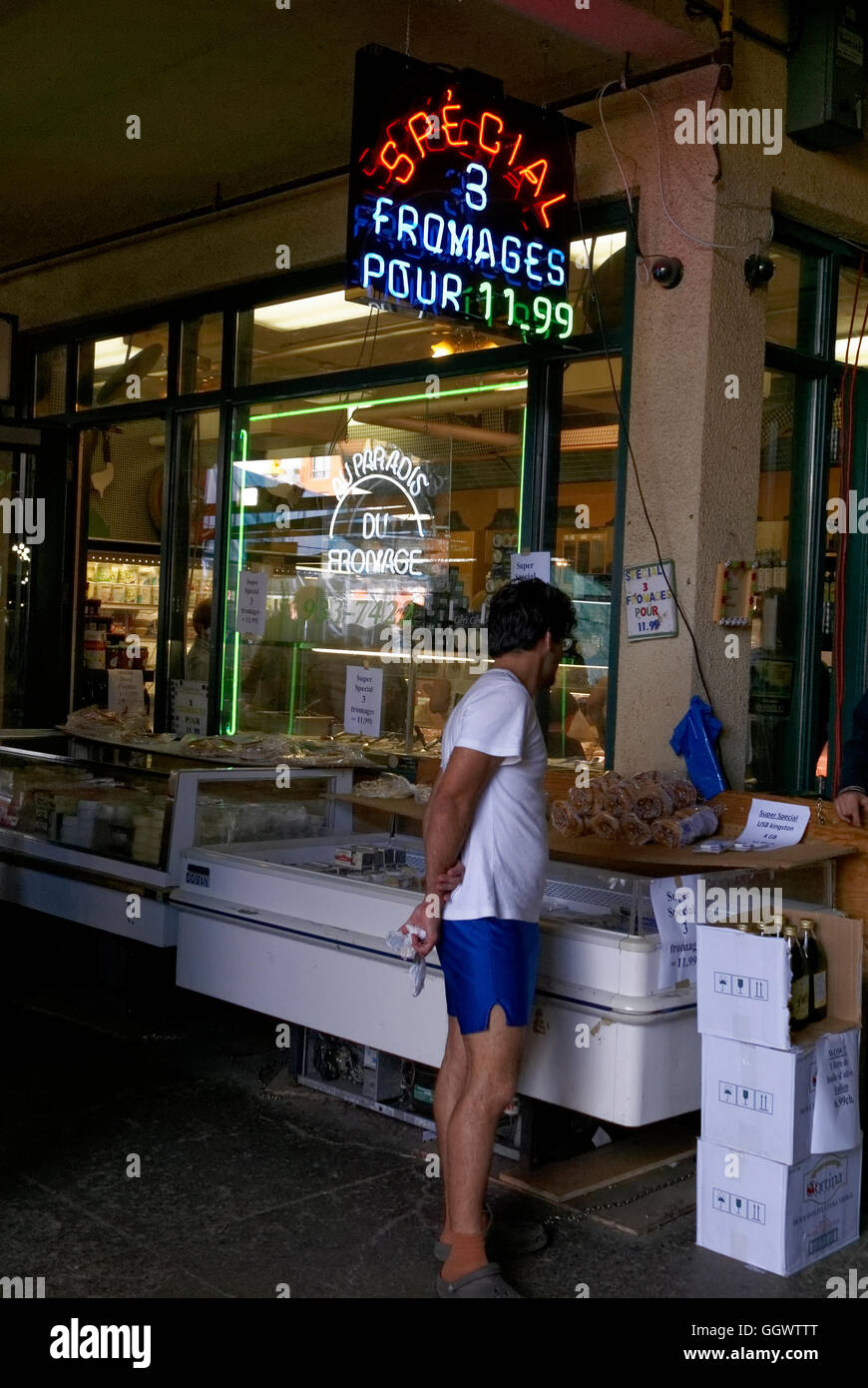 Man outside a cheese shop at the Atwater Market or Marché Atwater, Montreal, Quebec, Canada - Stock Image
