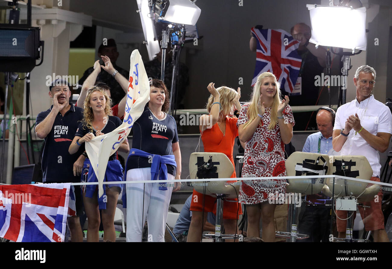 Mark and Caroline Peaty (left) with girlfriend Anna Zair in the BBC studio as they await the Men's 100m Final - Stock Image