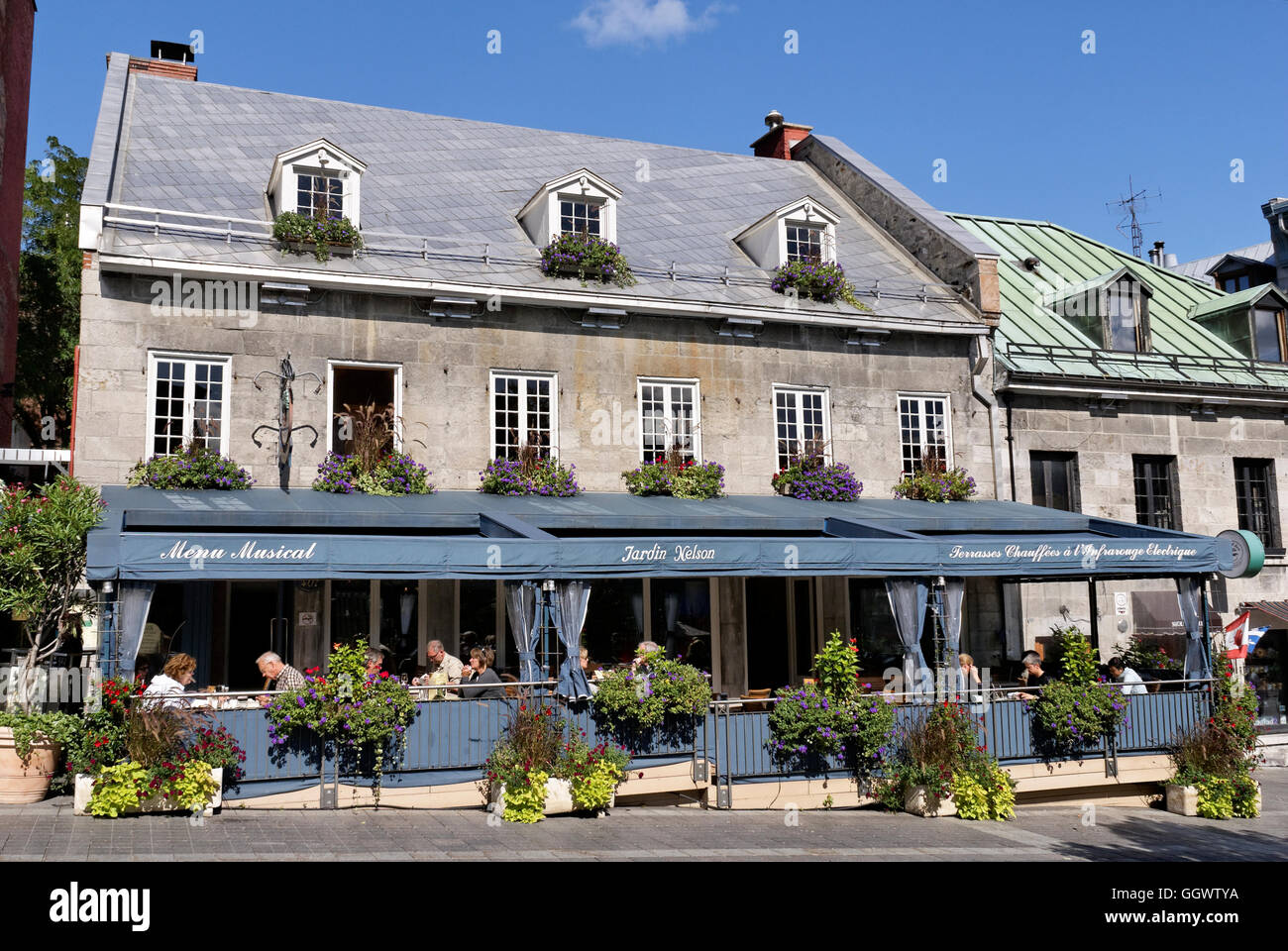 People Dining In The Jardin Nelson A French Restaurant On Place