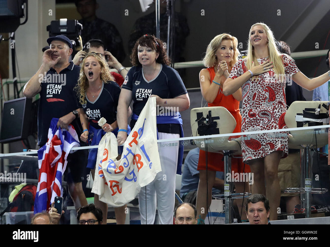 Mark and Caroline Peaty (left) with girlfriend Anna Zair in the BBC studio during the Men's 100m Final where - Stock Image