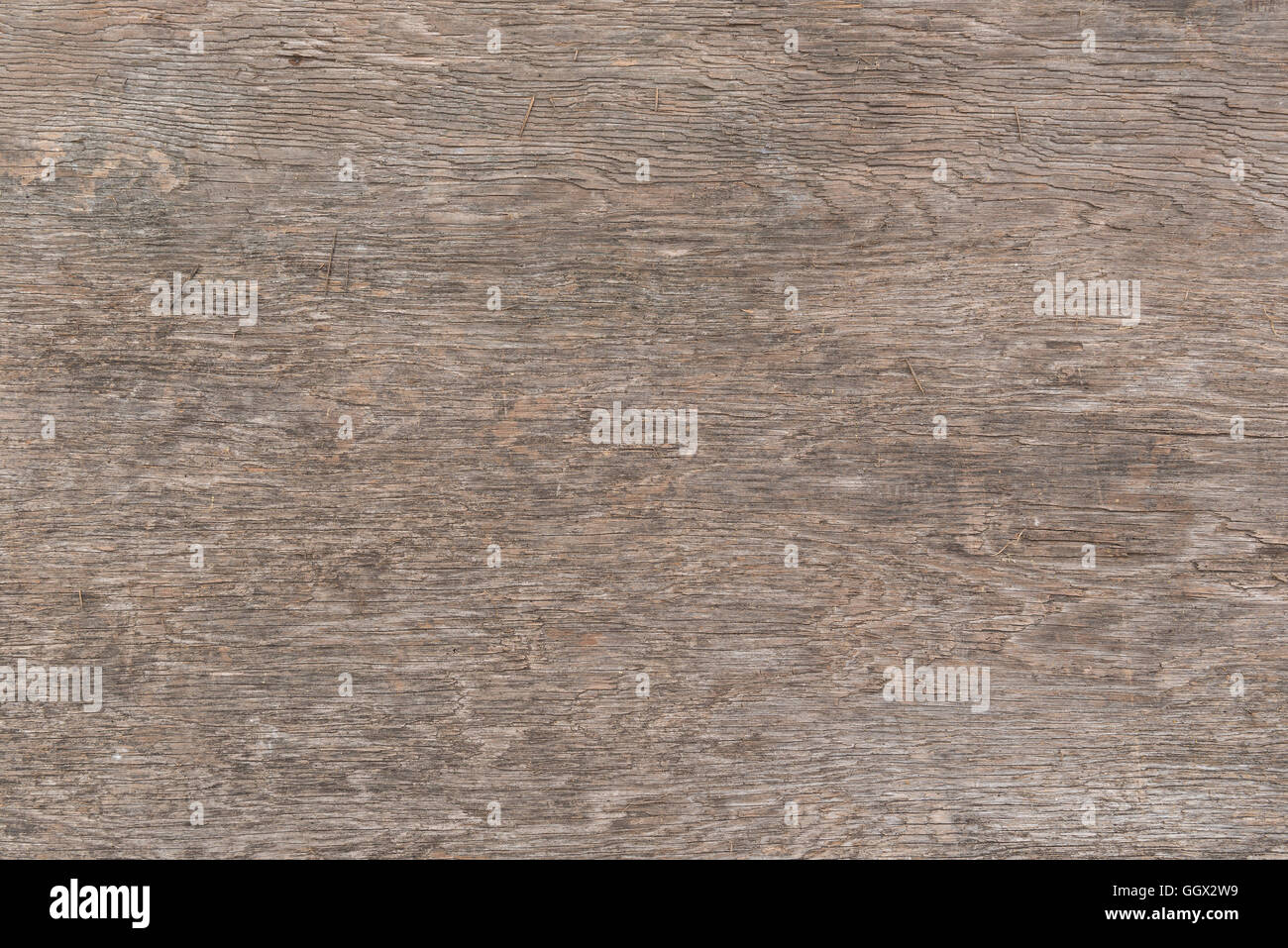 Weathered wooden plate as background picture - Stock Image