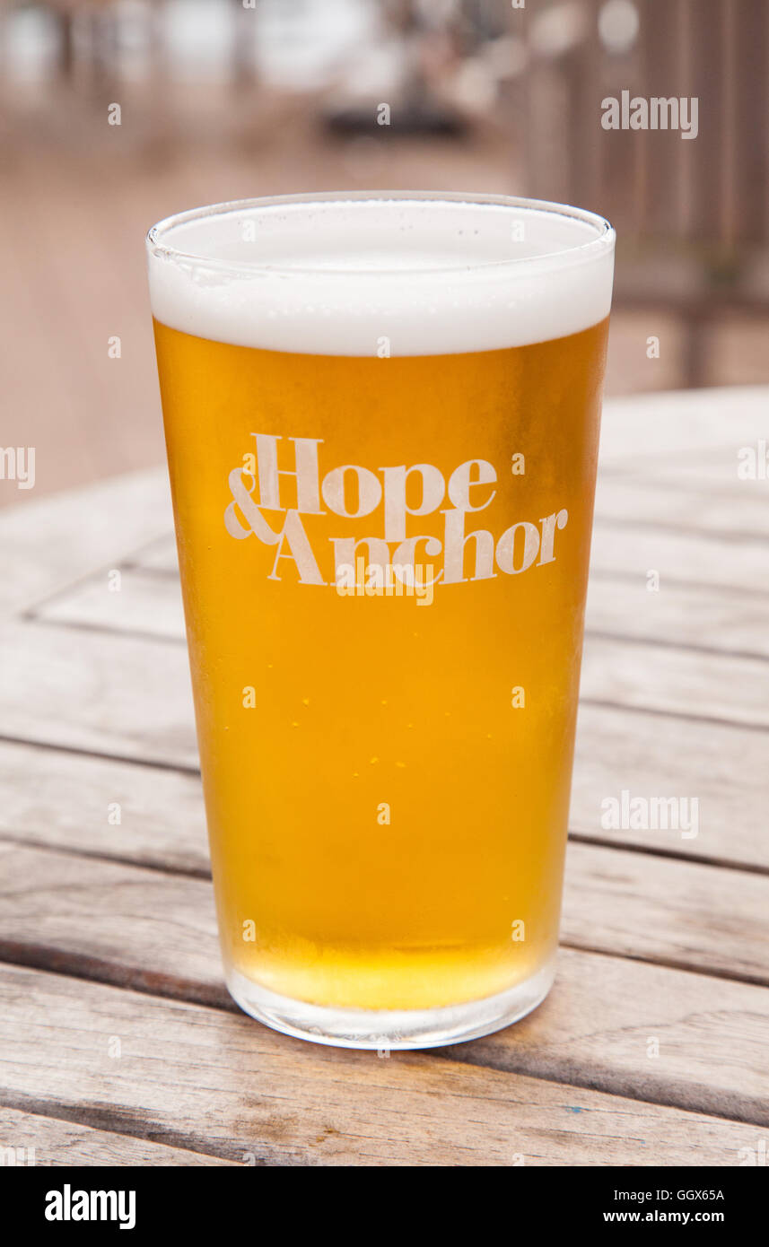 Pint of Larger at the Hope & Anchor pub, Hope Cove, South Devon, England, United Kingdom. - Stock Image