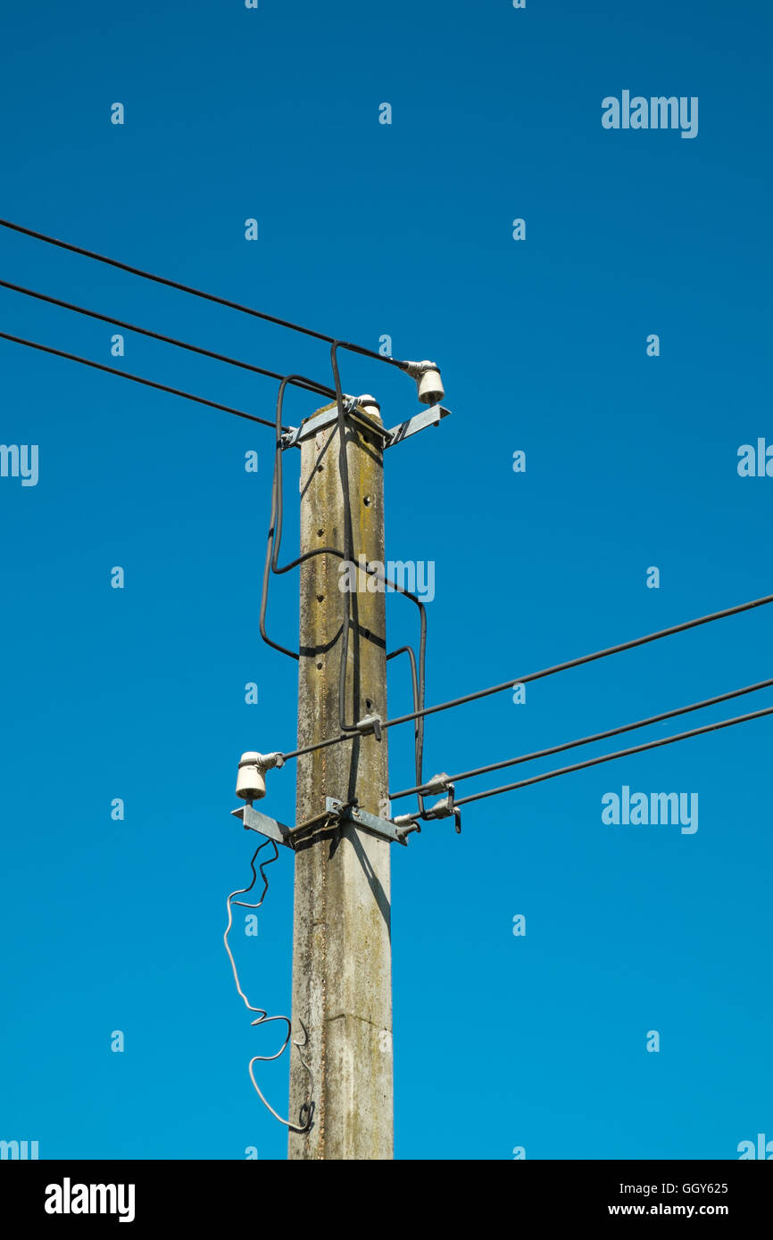 Unsafe looking concrete electricity pylon - Stock Image