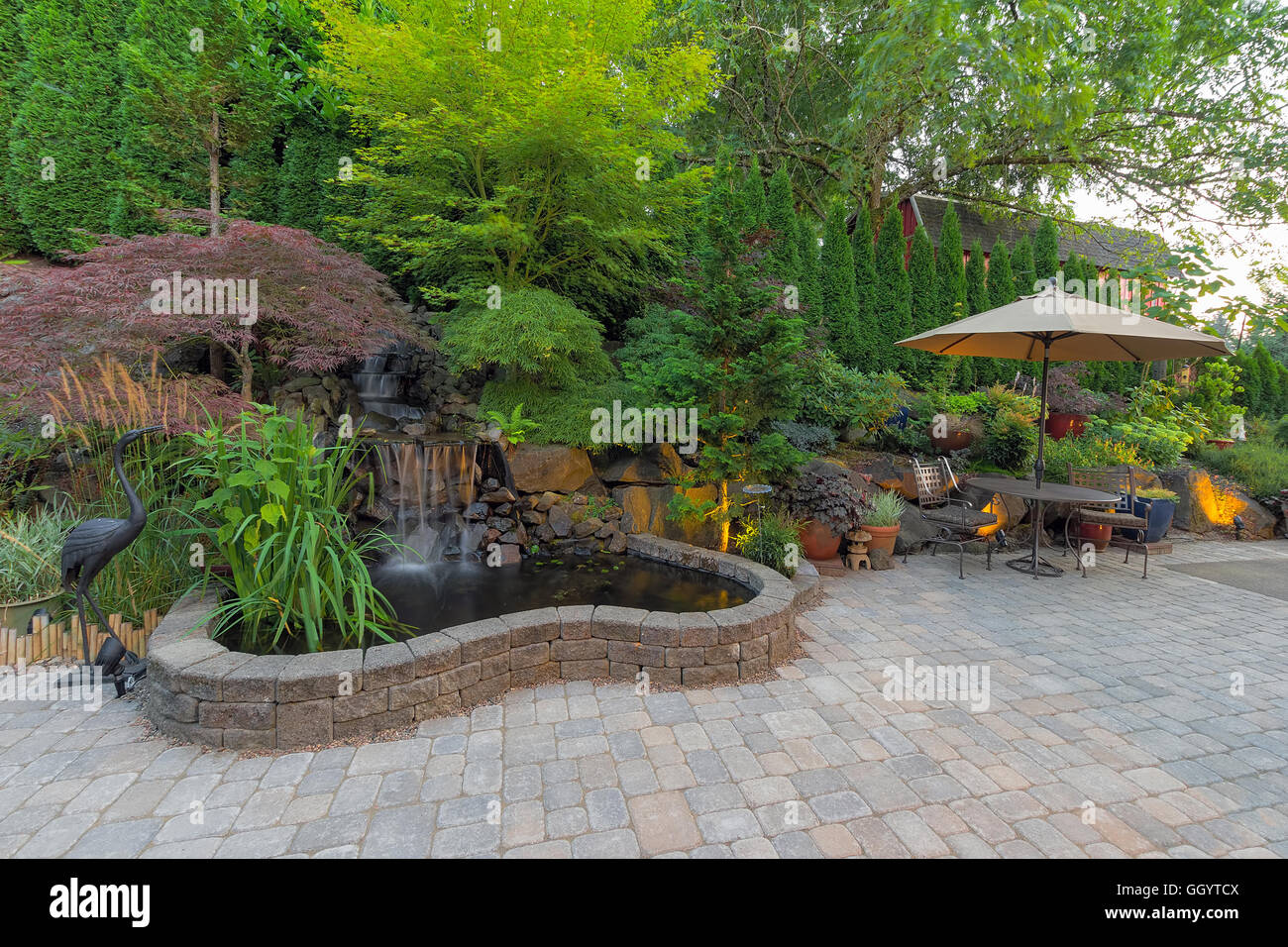 Backyard Garden Landscaping With Waterfall Pond Trees Plants Trellis Stock Photo Alamy
