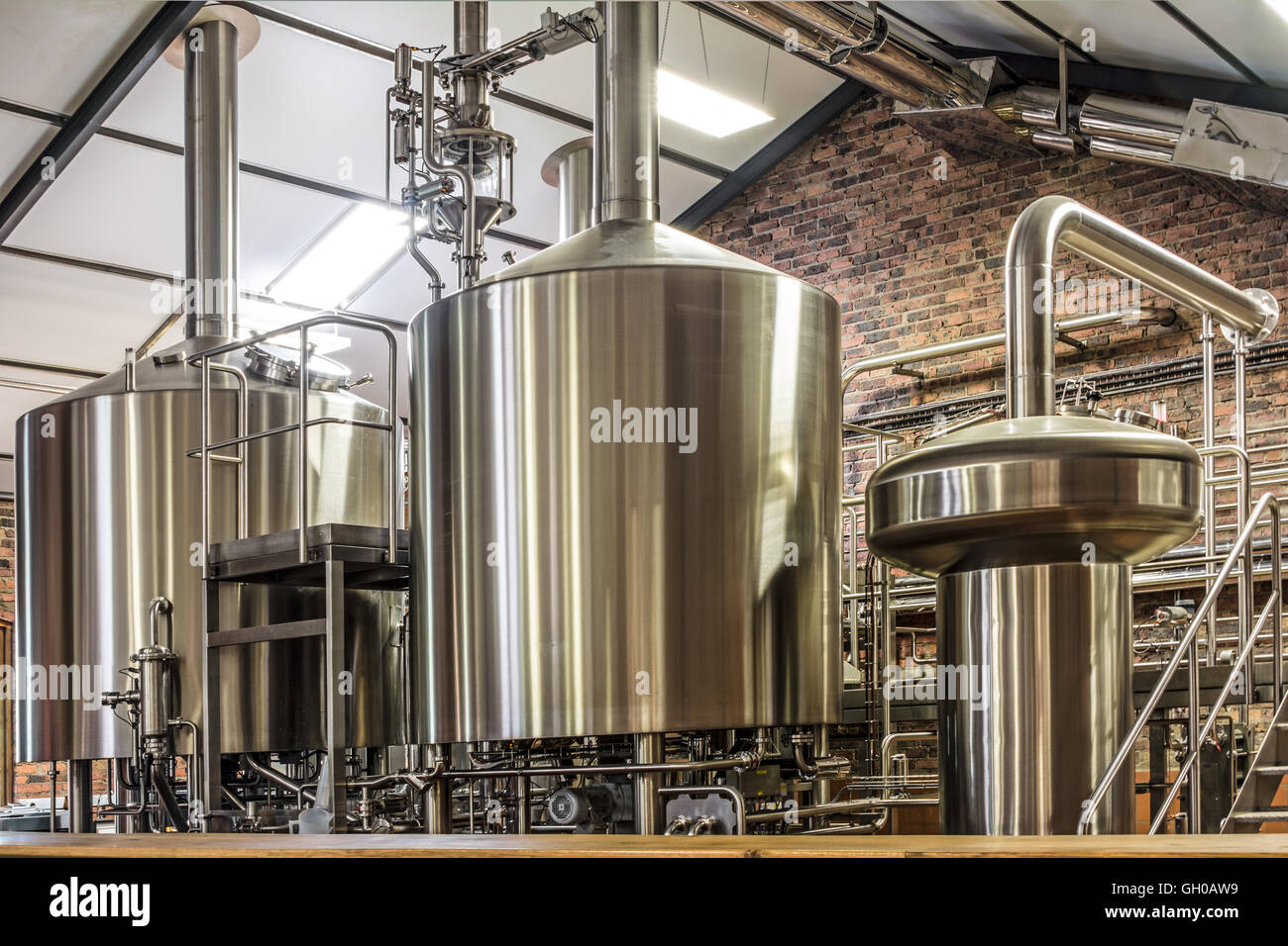 Modern Beer Plant (brewery), With Brewing Kettles, Vessels, Tubs And Pipes  Made Of Stainless Steel.